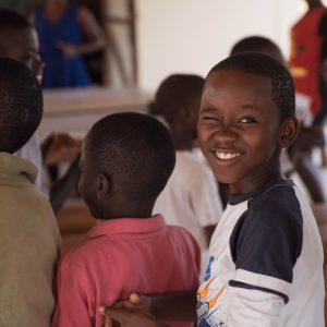 Sawla student winks at photographer Sean Tobin during school activities.