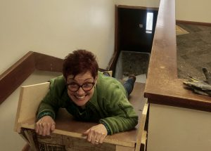 Stephanie P. smiles while holding on to the top of a debris shoot