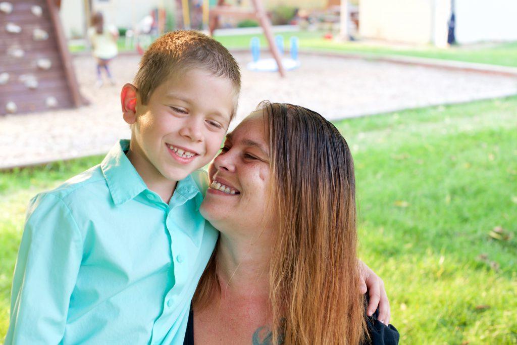 Mom and son pose at NAOMI