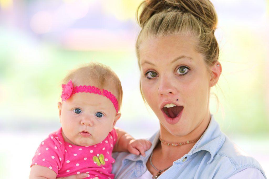 Mom and baby girl pose at NAOMI
