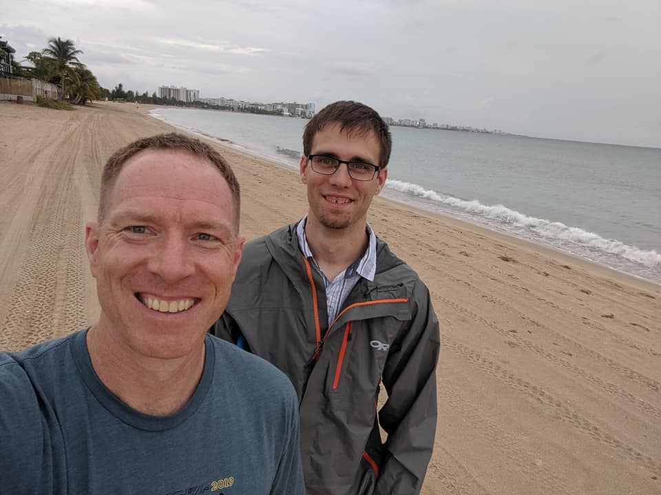 Mark and Kevin take a selfie on the beach.