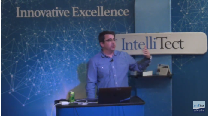 Screenshot of Michael Stokesbary presenting in front of the IntelliTect logo